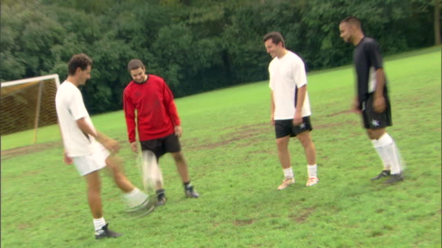 time-lapse of men kicking soccer ball - see other clips from this shoot 1280 stock videos & royalty-free footage