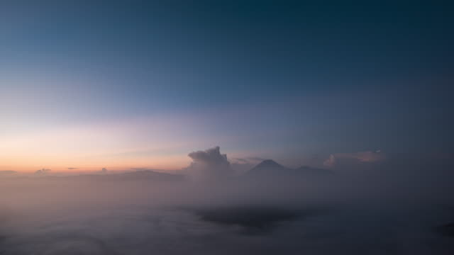 timelapse of mount bromo and semeru at sunrise - bromo crater stock videos & royalty-free footage