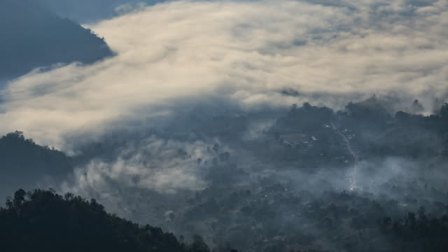 Time-lapse of mountain and moving mist