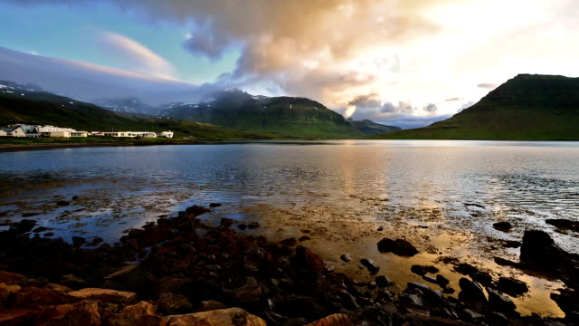 timelapse of moving cloud over kirkjufell mountain, iceland - reykjavik stock videos and b-roll footage
