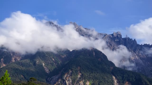timelapse of moving clouds over mount kinabalu in sabah, malaysia - mt kinabalu national park stock videos and b-roll footage
