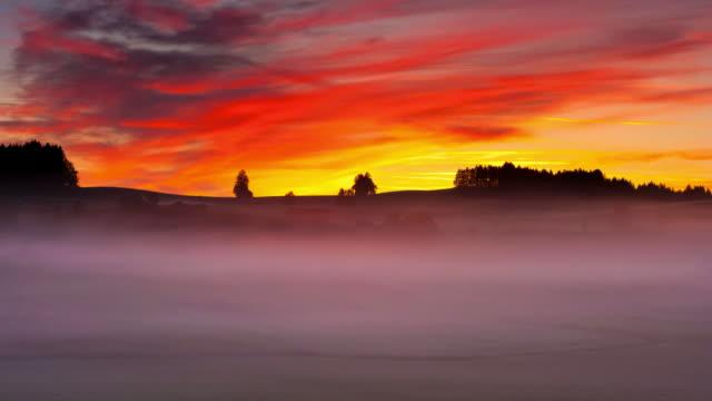 timelapse of moving fog in bavaria germany, sunrise, morning