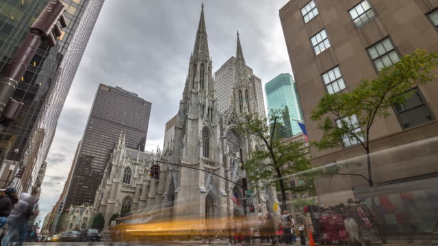 timelapse of new york's saint patric's cathedral with car traffic. usa, 2017 - st. patrick's cathedral manhattan stock videos and b-roll footage