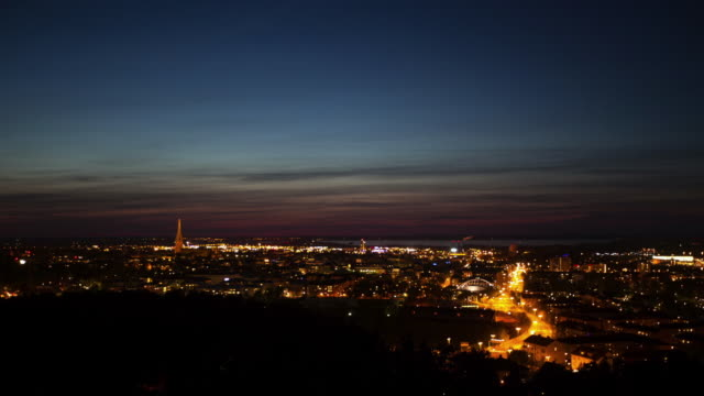 timelapse of night falling over newcastle - newcastle upon tyne stock-videos und b-roll-filmmaterial