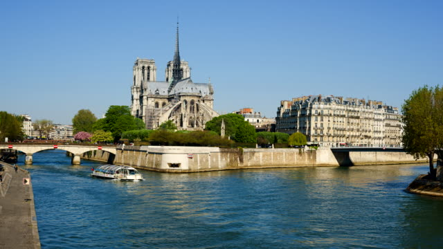 time-lapse of notre dame cathedral and river seine, paris. - notre dame de paris stock videos and b-roll footage