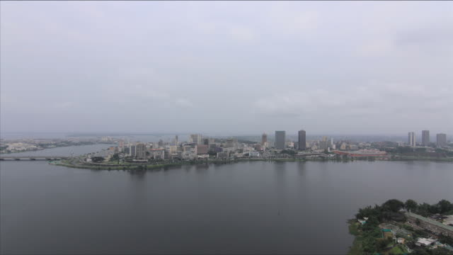 time-lapse of overcast city during the day/ abidjan/ ivory coast - côte d'ivoire stock videos & royalty-free footage