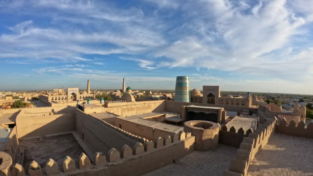 time-lapse of panorama of ancient city of khiva, uzbekistan - madressa stock videos and b-roll footage