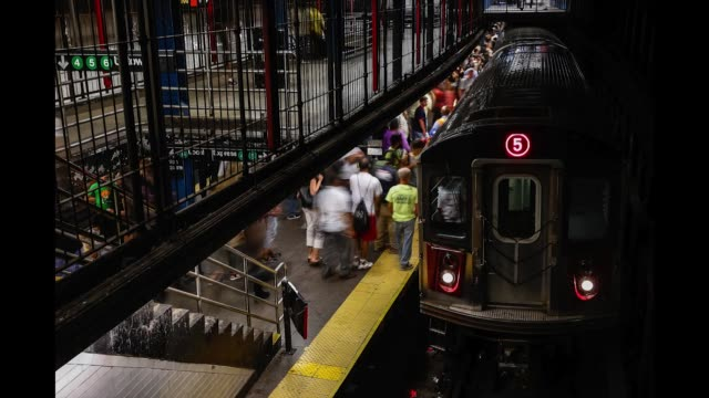 timelapse of passengers wait on the uptown express platform at union square subway station in new york united states on thursday july 6 2017 - union square new york city stock videos & royalty-free footage