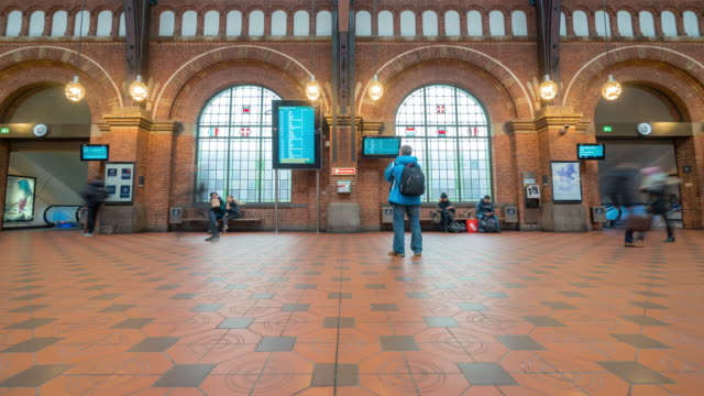 time-lapse of pedestian trabeller crowded at copenhagen train station terminal - railway station stock videos and b-roll footage