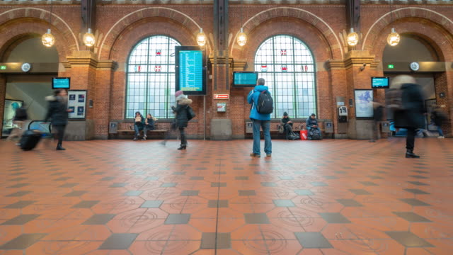 time-lapse of pedestian trabeller crowded at copenhagen train station terminal - pedestrian stock videos & royalty-free footage