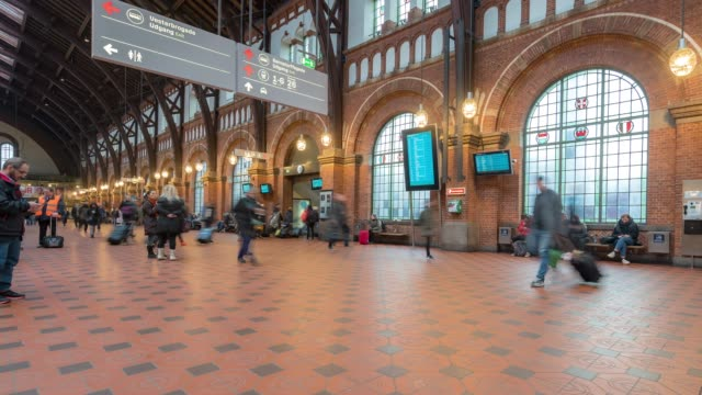 time-lapse of pedestian trabeller crowded at copenhagen train station terminal - copenhagen stock videos & royalty-free footage