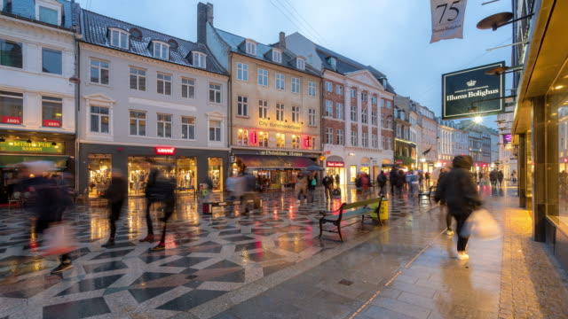 time-lapse of pedestrian crowded stroget shopping street in copenhagen denmark - denmark stock videos & royalty-free footage