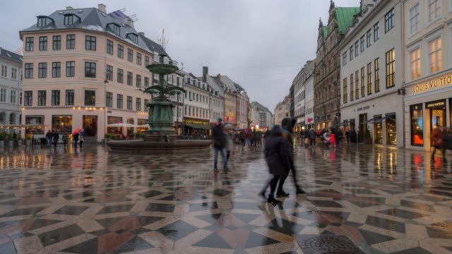 time-lapse of pedestrian crowded stroget shopping street in copenhagen denmark - public building stock videos and b-roll footage