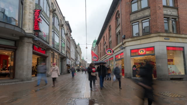 time-lapse of pedestrian crowded stroget shopping street in copenhagen denmark - pedestrian stock videos and b-roll footage