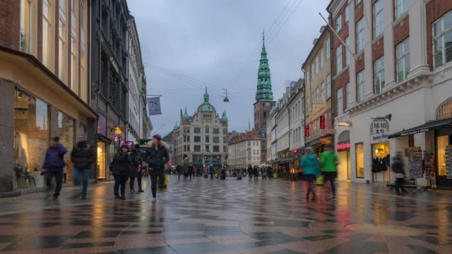 time-lapse of pedestrian crowded stroget shopping street in copenhagen denmark - high street stock videos & royalty-free footage