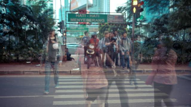 Timelapse of people crossing a road in Jakarta