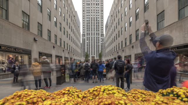 timelapse of people crowd near famous rockefeller center in new york. usa, 2017 - rockefeller centre stock videos & royalty-free footage