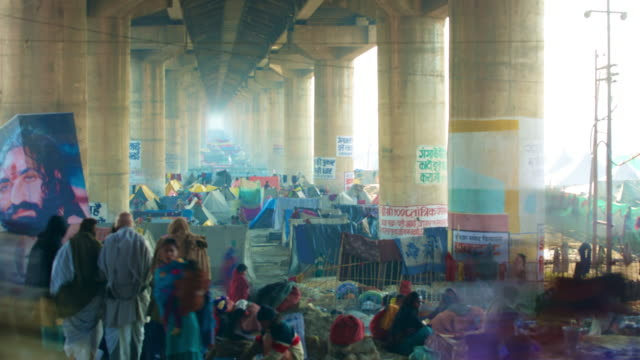 Timelapse of people crowded under a bridge during the religious festival Kumbh Mela in India