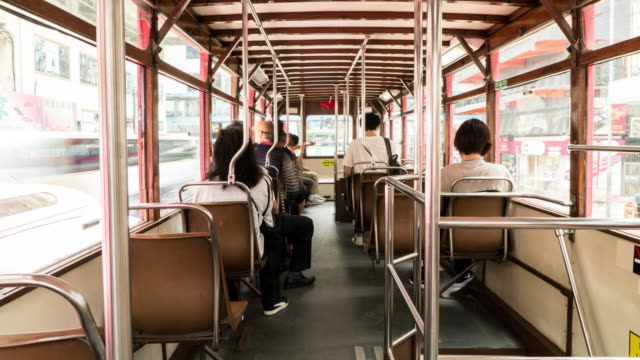 Timelapse of people on the upper deck inside a double-decker tram.