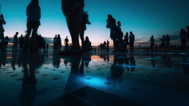 timelapse of people reflections on colorful sunset in zadar, croatia - flooring stock videos & royalty-free footage