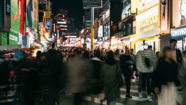 timelapse of people traveling and shopping in hongdae street market at seoul, south korea. hongdae district is the most popular shopping market at seoul city. - south korea stock videos and b-roll footage