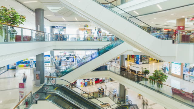 timelapse of people use escalator and shopping in mall - department store stock videos & royalty-free footage