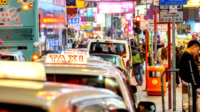 4k timelapse of people waiting taxi at taxi queue in market night - sign stock videos & royalty-free footage