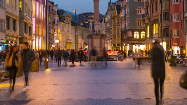 timelapse of people walking and shopping in innsbruck town center, austria night time - austria stock videos & royalty-free footage