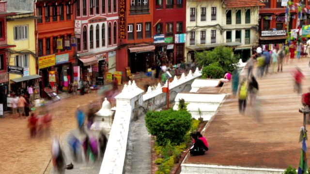Time-lapse of people walking around the streets at Boudhanath Stupa in Kathmandu. Cropped.