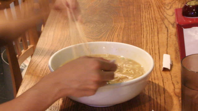 timelapse of person eating ramen noodles - ramen noodles stock videos & royalty-free footage