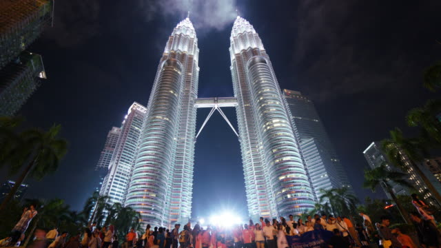 timelapse of petronas twin towers - petronas twin towers stock videos and b-roll footage
