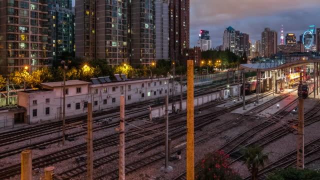Timelapse of railway and light rail beside Shanghai Railway Station