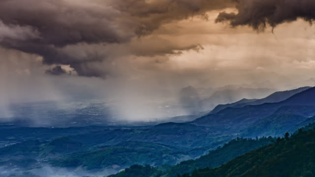 Time-lapse of rain in mountain at sunset time , 4k(UHD)