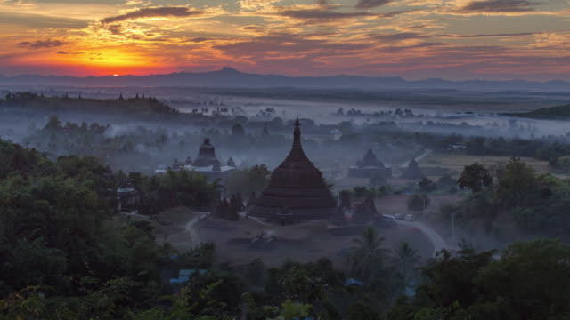 4k timelapse of ratanabon paya in mrauk-u - myanmar stock videos and b-roll footage