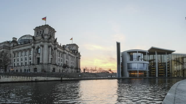 4k timelapse of reichstag building (german government) and river spree in berlin, germany - germany stock videos & royalty-free footage