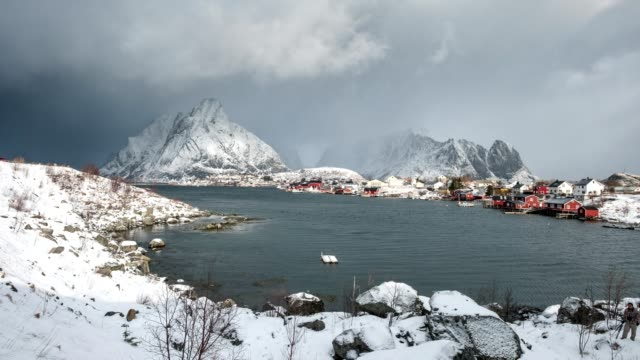 Time-lapse of Scandinavian village in gloomy valley on coastline, Reine, Lofoten, Norway