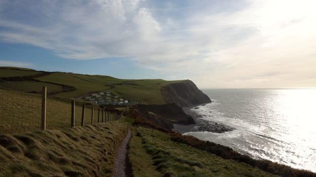 timelapse of shadow seeping over ceredigion coastline - coastline stock videos & royalty-free footage