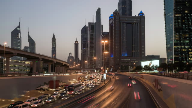 timelapse of sheikh zayed road in dubai - financial district stock videos & royalty-free footage