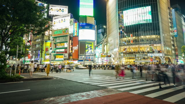time-lapse of shibuya crossing at night - digital composite stock videos & royalty-free footage