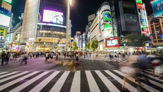 time-lapse of shibuya crossing at night - multiple exposure stock videos & royalty-free footage