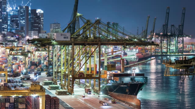 T/L timelapse of Singapore container port, cargo ship being unloaded