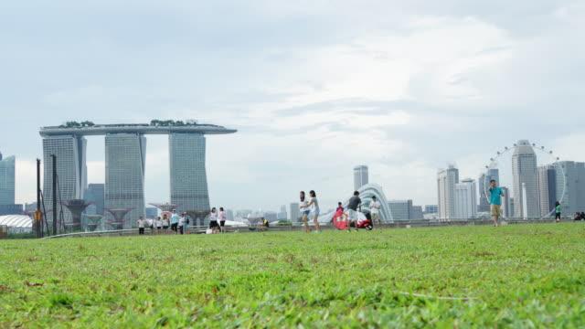 timelapse of singapore skyline from marina barrage - marina stock videos & royalty-free footage