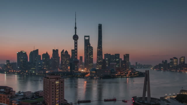 time-lapse of skyline in shanghai, night to day transition - river huangpu stock videos & royalty-free footage