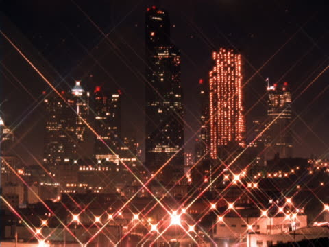 Timelapse of skyscrapers forming a grid of light
