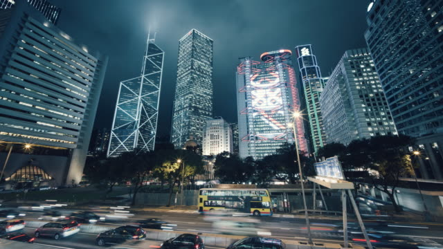 time-lapse of skyscrapers of central district, hong kong at dusk - bank financial building stock videos and b-roll footage