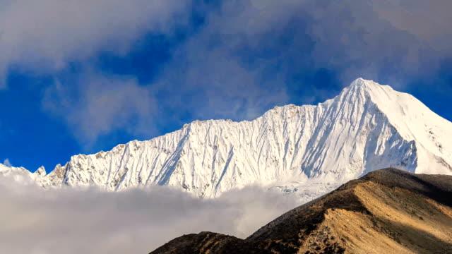 timelapse of snow mountain in tibet - tibetan plateau stock videos & royalty-free footage