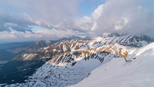 timelapse of snowy mountain landscape - snowcapped mountain stock videos & royalty-free footage