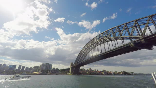 timelapse of storm clouds with the sydney harbour bridge - weather stock videos & royalty-free footage