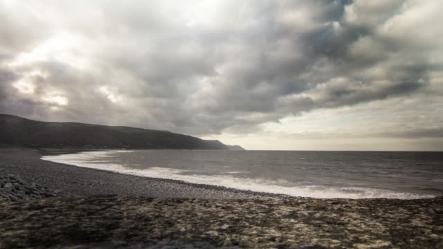 timelapse of storm passing english coastline - exmoor national park stock videos & royalty-free footage