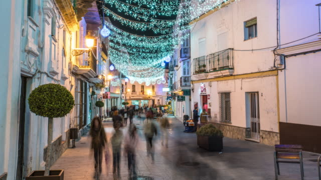 stockvideo's en b-roll-footage met timelapse of street at christmas, with lights and people shoping - silvestre